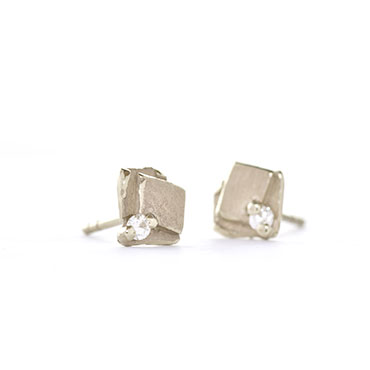 Playful square ear studs with diamond