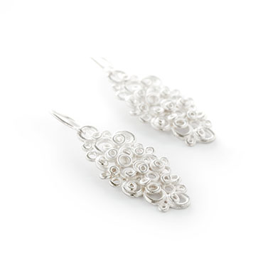Big earrings with lace motif