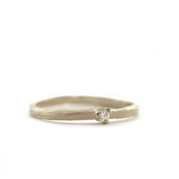 Fine ring with diamond and subtle structure