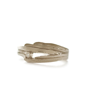 wrapped ring in gold with diamond