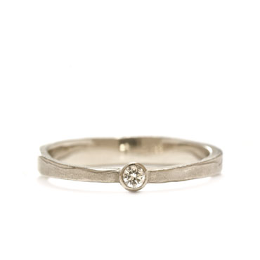 Thin classic engagement ring with brilliant
