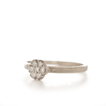 Ring with unique flower-shaped setting