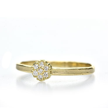 engagement ring with diamond in flower setting