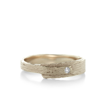 narrow engagement ring with wood texture in gold