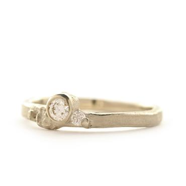 thin ring with structure and 2 diamonds
