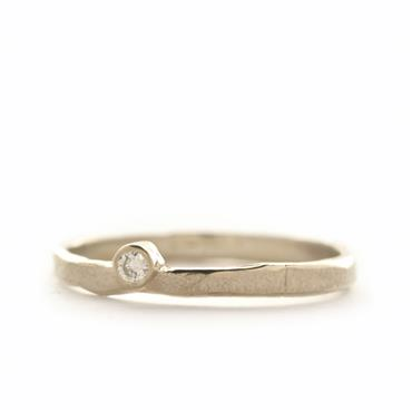 thin ring with off centered diamond