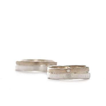 Silver and gold wedding band with a joint
