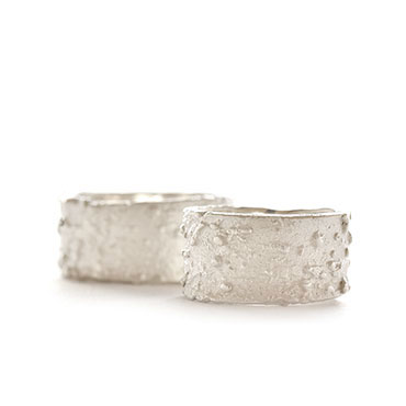 Wide wedding band with coarse texture
