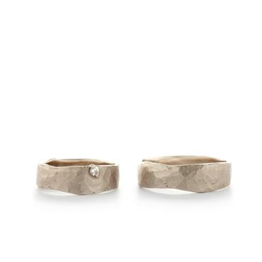 Golden wedding rings with hammered texture