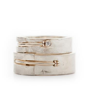 Silver wedding rings with detail in gold